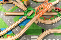Plastic wooden track for train toy. On colorful carpet Stock Photo