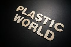 Plastic World. Words in white letters on black background text illustration design type graphic creative concept stock photos