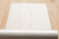 Plastic wrap. Isolated on wood stock image