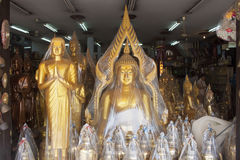 Plastic wrapped Buddha statues Royalty Free Stock Photos