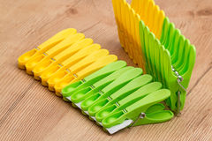 Plastic yellow and green clothespin Royalty Free Stock Photography