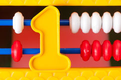 Plastic number one on the background of children's expense Stock Images
