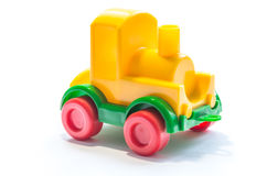 Plastic yellow train. Isolated yellow plastic toy train Stock Images
