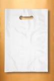 Plastic zak op goud Royalty-vrije Stock Fotografie