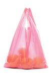 Plastic zak van sinaasappelen stock foto