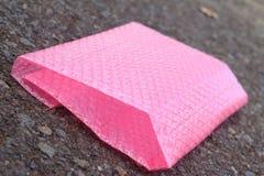 Plastica antiurto rosa per protezione di impatto fotografia stock