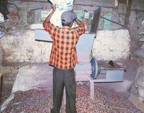 Plastica che è grattata durante il riciclaggio Fotografia Stock