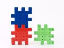 Plastica del puzzle Fotografie Stock