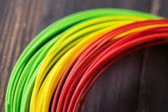 Plastica dell'ABS per 3D la stampante, fondo di legno Fotografie Stock