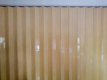 Plastica gialla delle tende Fotografia Stock