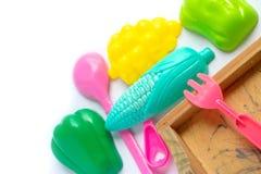 Plastica variopinta del giocattolo isolata su fondo bianco Fotografia Stock