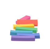 Plasticine. Seven pieces of plasticine which are located on a white surface Stock Photo
