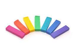 Plasticine. Seven pieces of plasticine which are located on a white surface Royalty Free Stock Photo
