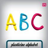 Plasticine alphabet on a background. Stock Photos