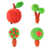 Plasticine apple trees. Plasticine isolated apple trees on the white background Stock Photo