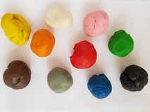 Plasticine balls in various colors, background and texture. School material to mold, stimulates child education and creativity, skills development royalty free stock image