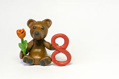 Plasticine bear with flower and eight figure Royalty Free Stock Image