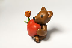 Plasticine bear with flower and eight Stock Images