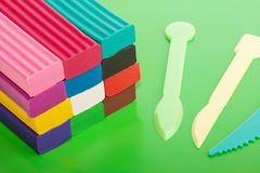 Plasticine blocks on a board Royalty Free Stock Photography