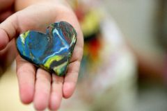 Plasticine brown and blue abstract heart Royalty Free Stock Photo