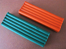 Plasticine on brown paper Royalty Free Stock Photography