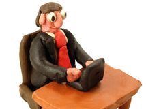 Plasticine businessman. Comical plasticine businessman sitting with laptop on a white background Royalty Free Stock Image