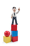Plasticine businessman on cubes Royalty Free Stock Images
