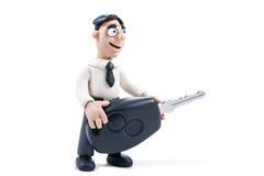 Plasticine businessman with key Stock Photo