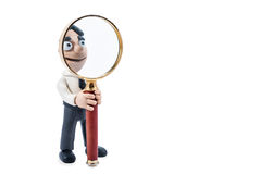 Plasticine businessman with magnifying glass Royalty Free Stock Photography