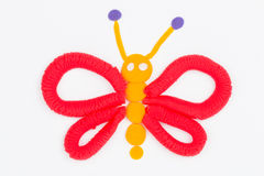 Plasticine butterfly. Royalty Free Stock Images