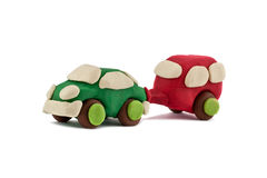Plasticine car pulls trailer camping isolated on white background Royalty Free Stock Images