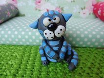 Plasticine cat. Cold porcelain clay sculpted puppet Stock Photography