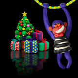 Plasticine christmas tree with monkey Stock Images