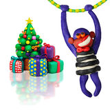 Plasticine christmas tree with monkey Royalty Free Stock Photography