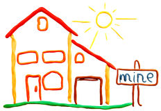 Plasticine cottage and sun Royalty Free Stock Image