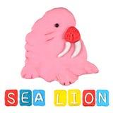 Plasticine del león marino de los niños del color imagenes de archivo