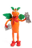 Plasticine dragon. With dollars isolated on white royalty free stock photos