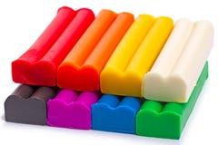Plasticine eight colors on white Stock Photo