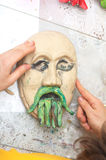 Plasticine face with moustache sculpting Stock Photography