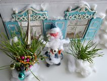 Plasticine Father frost with New Year trees. Wonderful Christmas photo of Santa and old beautiful house in Russian style Stock Photo