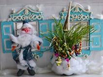 Small New Year tree, Santa and hut - magic photo. Plasticine Father Frost, small New Year tree and old house - New Year card Royalty Free Stock Photography