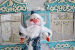 Portrait of happy small Santa. Plasticine Father Frost is waving his hand - New Year card Royalty Free Stock Photo