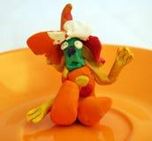 Plasticine figure. A funny plasticine figure on a plate Stock Image