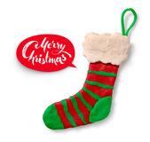 Plasticine figure of Christmas sock. Hand made plasticine figure of Christmas sock with shadow on white background and red lettering banner Stock Photography