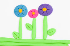 Plasticine flower. Royalty Free Stock Images