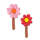 Plasticine flowers. Two color flowers made from child plays plasticine Royalty Free Stock Images