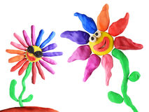 Plasticine flowers friendship. On the white background Royalty Free Stock Images