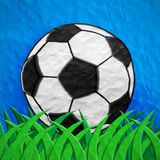 Plasticine Football on grass Royalty Free Stock Photography
