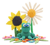 Plasticine frog and flowers. Royalty Free Stock Image