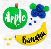 Plasticine fruits apple Stock Images